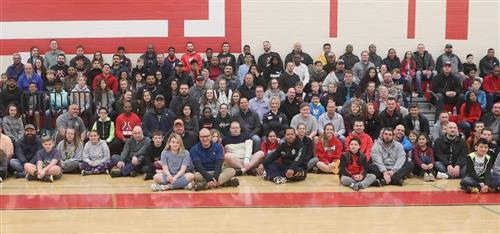 Dads and students pose for a picture at the ALL PRO DAD breakfast on December 14.