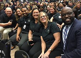 CTHS Assistant Principals and Principal Walter Berringer pose for a picture at Convocation.