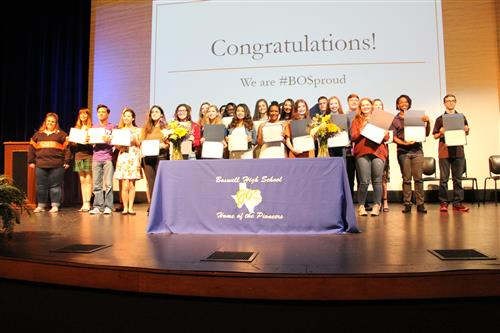 Boswell Fine Arts students pose for a group picture with their certificates at their Signing Day.