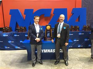 Coach Briley poses with NCAA Championship trophy