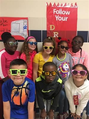 Bryson Elementary students pose for a group picture while wearing sunglasses.