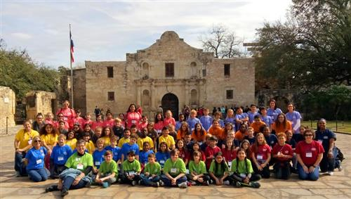 Bryson Elementary fourth-graders pose for a picture in front of the Alamo in San Antonio.