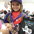 Caroline Dreese poses with her medal and plaque at the Texas Reading Bee.