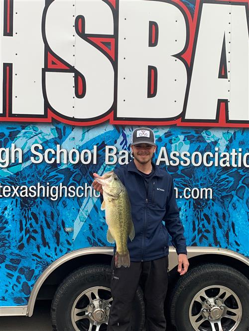 Chisholm Trail Angler Lucas Rhodes poses while holding up a bass at THSBA State.