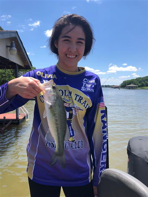 Chisholm Trail Angler Olivia DeVore poses while holding up a bass at THSBA State.