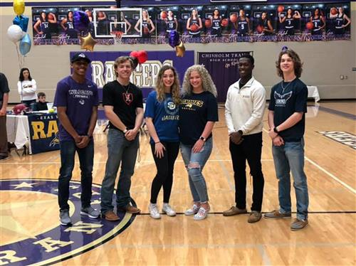 Chisholm Trail HS athletes pose for a group picture at National Signing Day.