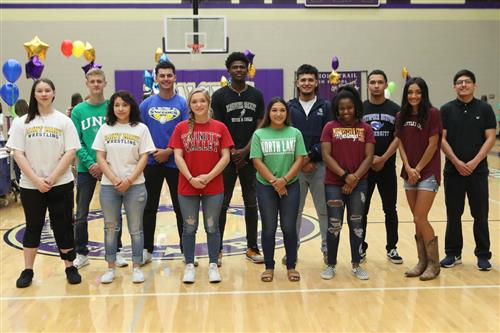Chisholm Trail athletes pose for a group picture in the gym at Signing Day.