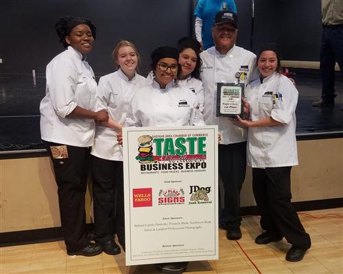 Culinary students and Chef Pearson pose with their 1st place plaque.