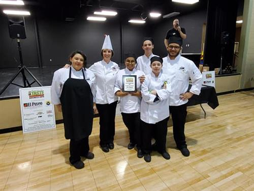 HCTC culinary students and teacher pose with their first place plaque.