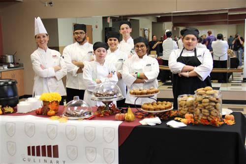 HCTC Culinary students and teacher pose at their Taste of Northwest table.