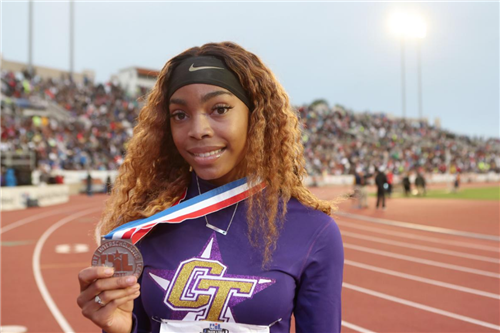 Deja Shaw-Huckaby poses with her second place medal for the 100m.