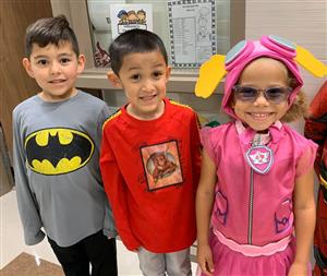 Dozier students pose for a picture while wearing their Superhero costumes.