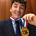 SHS senior Dylan Noone poses for a picture with his State Champion Medal in Poetry Interpretation.
