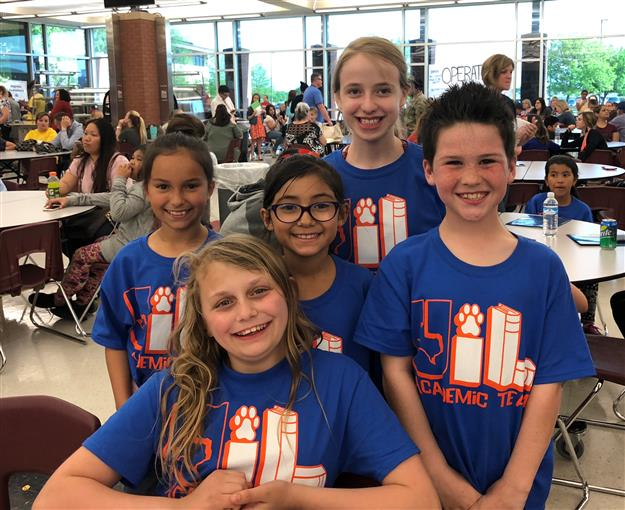 Team of students smiling at camera at elementary UIL competition