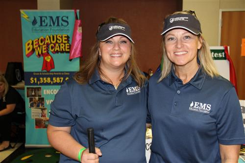 EMS Education Foundation director and coordinator pose for a picture at Taste of Northwest.