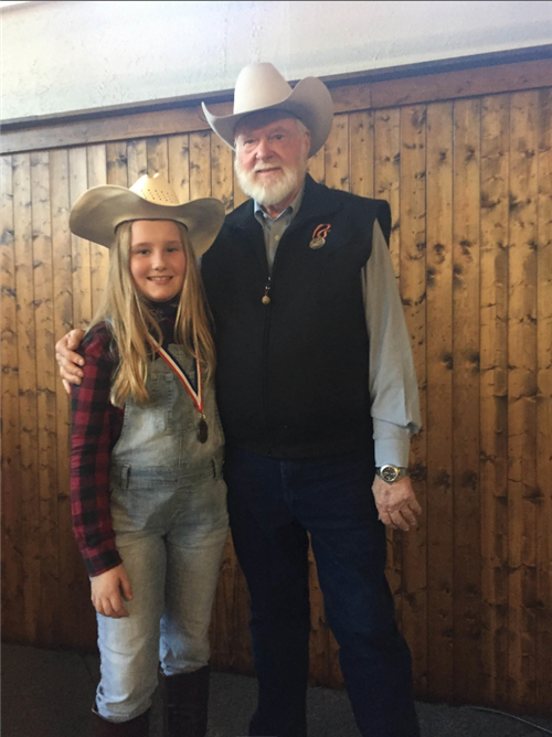Ella Van De Kieft with Red Steagall at the Cowboy Gathering Poetry Contest.