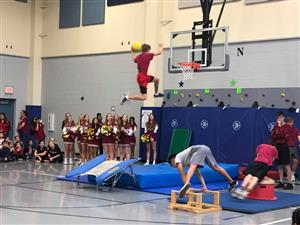 Saginaw HS gymnasts perform for Gililland Elementary students in the gym during Red Ribbon Week.