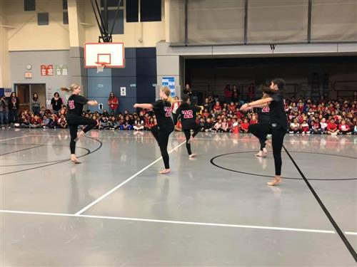 Saginaw HS drill team performs for Gililland Elementary students in the gym during Red Ribbon Week.