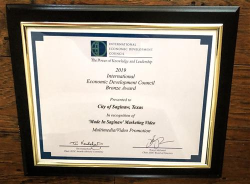 International Economic Development Council Bronze Award certificate for Made in Saginaw Marketing video in a frame.