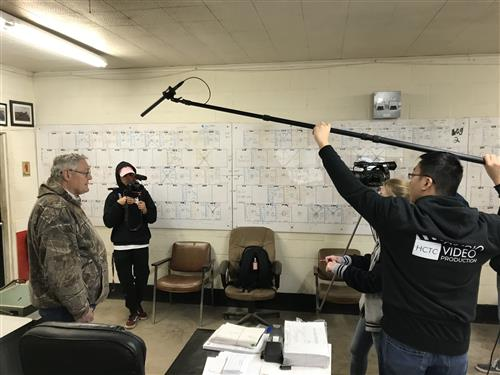 HCTC students interview and film a company in the City of Saginaw.