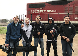 HCTC Audio/Video students pose with their equipment in front of Attebury Grain.