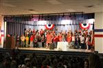 large group of 5th graders sing to vterans