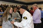 female student shakes hand of WW2 veteran