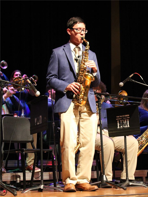 BHS student Jason Lunsford performs a saxophone solo at a band concert.
