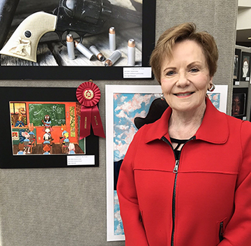 Congresswoman Kay Granger poses with Grimes' second place artwork.