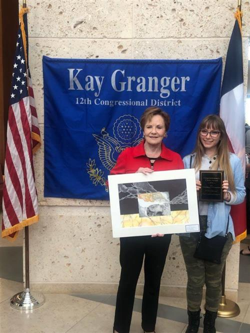 BHS student Kaylee Meyer poses with her artwork and Congresswoman Kay Granger.