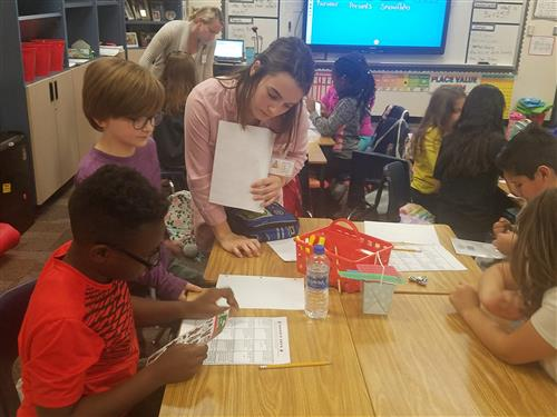 Maddy Carter works with elementary students in class.