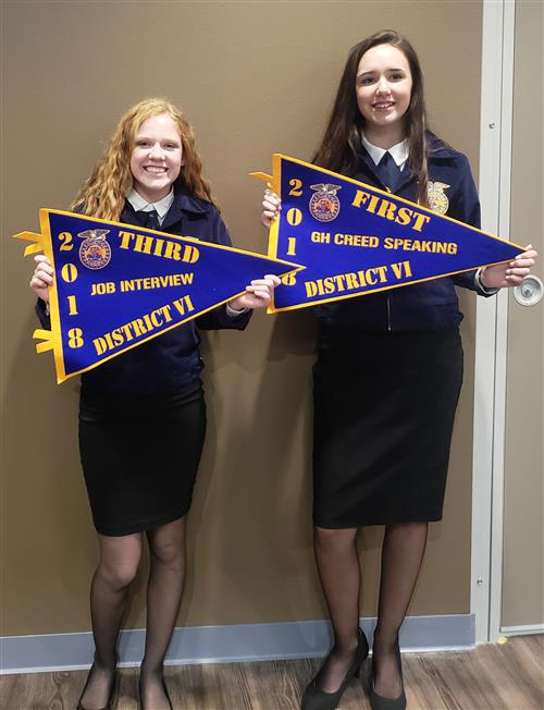Tamara Martin and Madison Wimbish pose with their third and first place pendants at FFA district contest.