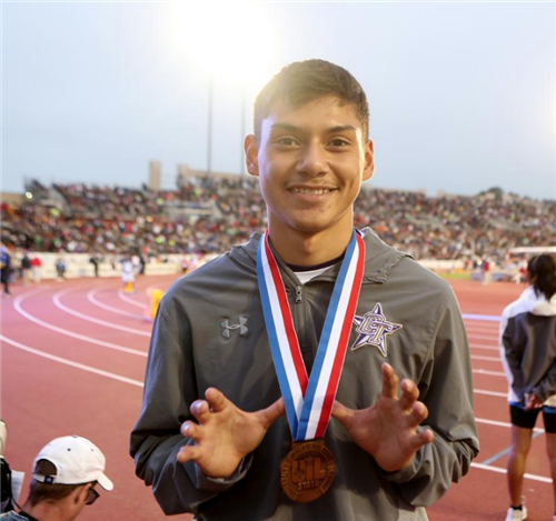 Nathan Franco poses with his third place medal for hurdles.