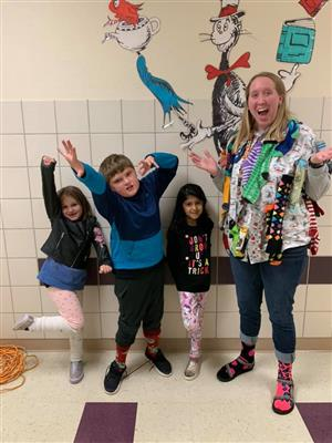 Northbrook Elementary students pose with their teacher showing off their crazy socks.