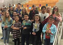 Students pose for pictures at HCTC on Jan. 14, 2019 with their PTA Reflections Contest trophies.