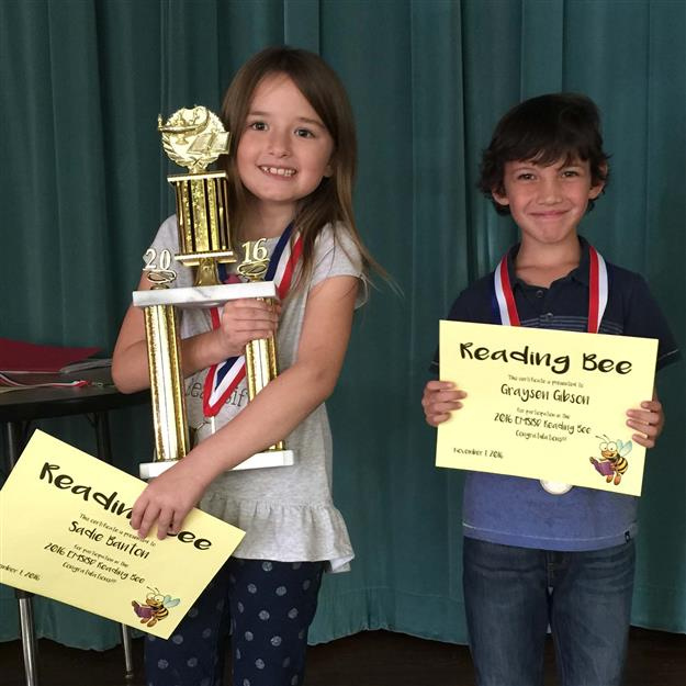 Reading Bee winner Sadie Banton and district runner up Graysen Gibson holding their awards
