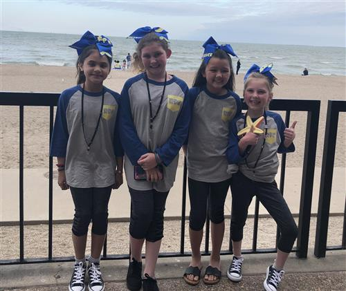 Remington Point Elementary Destination Imagination team poses for a picture on the beach.