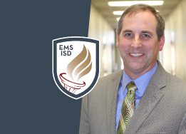 Portrait of Robb Welch with EMS ISD shield logo