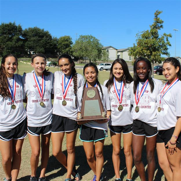 Photo of SHS girls cross country with medals and trophy