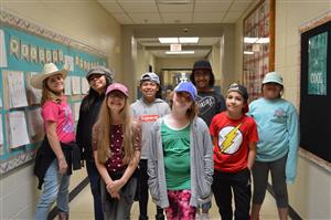 Saginaw Elementary students pose for a picture wearing their hats.