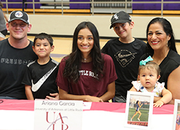 Chisholm Trail athlete Ariana Garcia poses with her family at the Spring Signing Day.