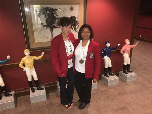 HCTC cosmetology student Esme Avalos poses with her instructor after earning Bronze at SkillsUSA.