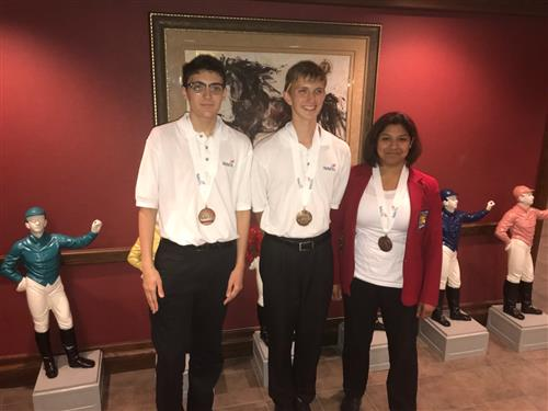 HCTC students Joseph Schinnerer, Andrew Hartnett, and Esme Avalos pose for a picture after earning medals at SkillsUSA.