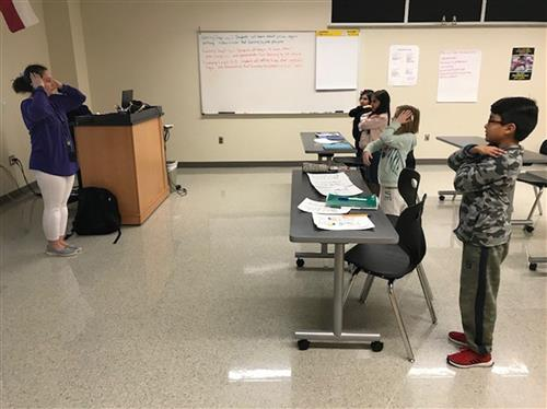 Students following teacher in World Languages Academy Spanish class