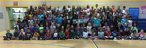 150 Greenfield students pose for a picture after help set a Guinness World Record.