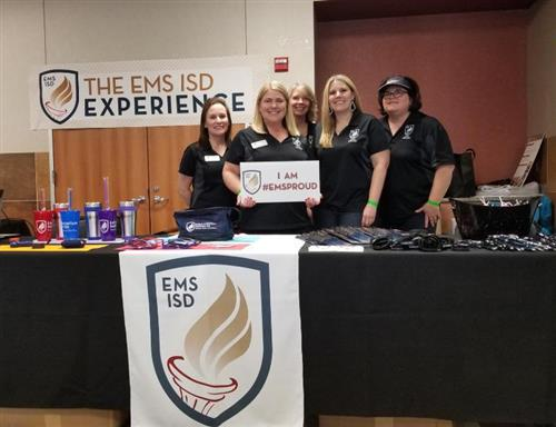 The EMS ISD Communications Department poses for a photo at Taste of Northwest.