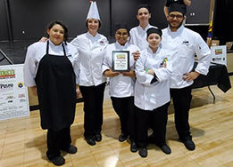 HCTC culinary students and teacher pose with their first place plaque at Taste of Northwest.