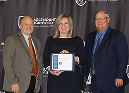 VLK principal Leesa Vardeman poses with Dr. Chadwell and Board President Steve Newcom