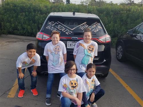 Willow Creek Destination Imagination team poses for a group picture in the parking lot .