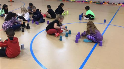 Greenfield students participate in speed stacking cups during PE class.